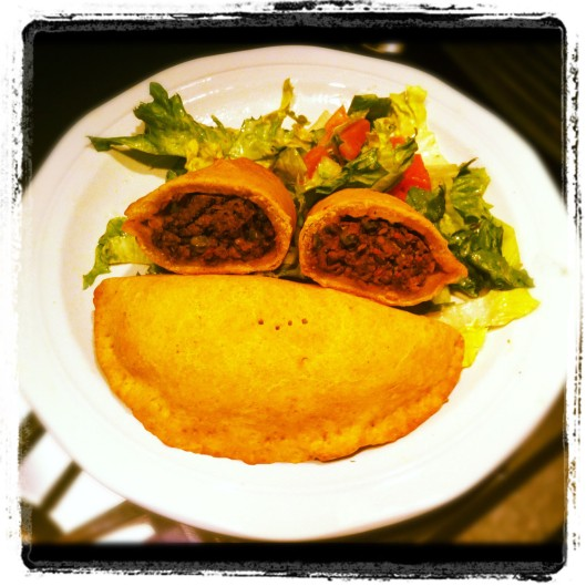 Image of Jamaican beef patty served with a salad