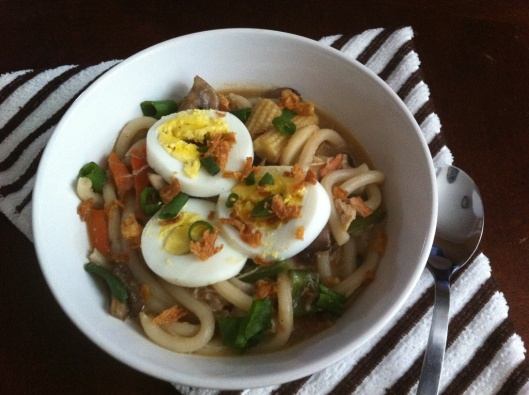 Chicken & Bacon Udon Noodles Topped with sliced eggs, scallions and fried onions