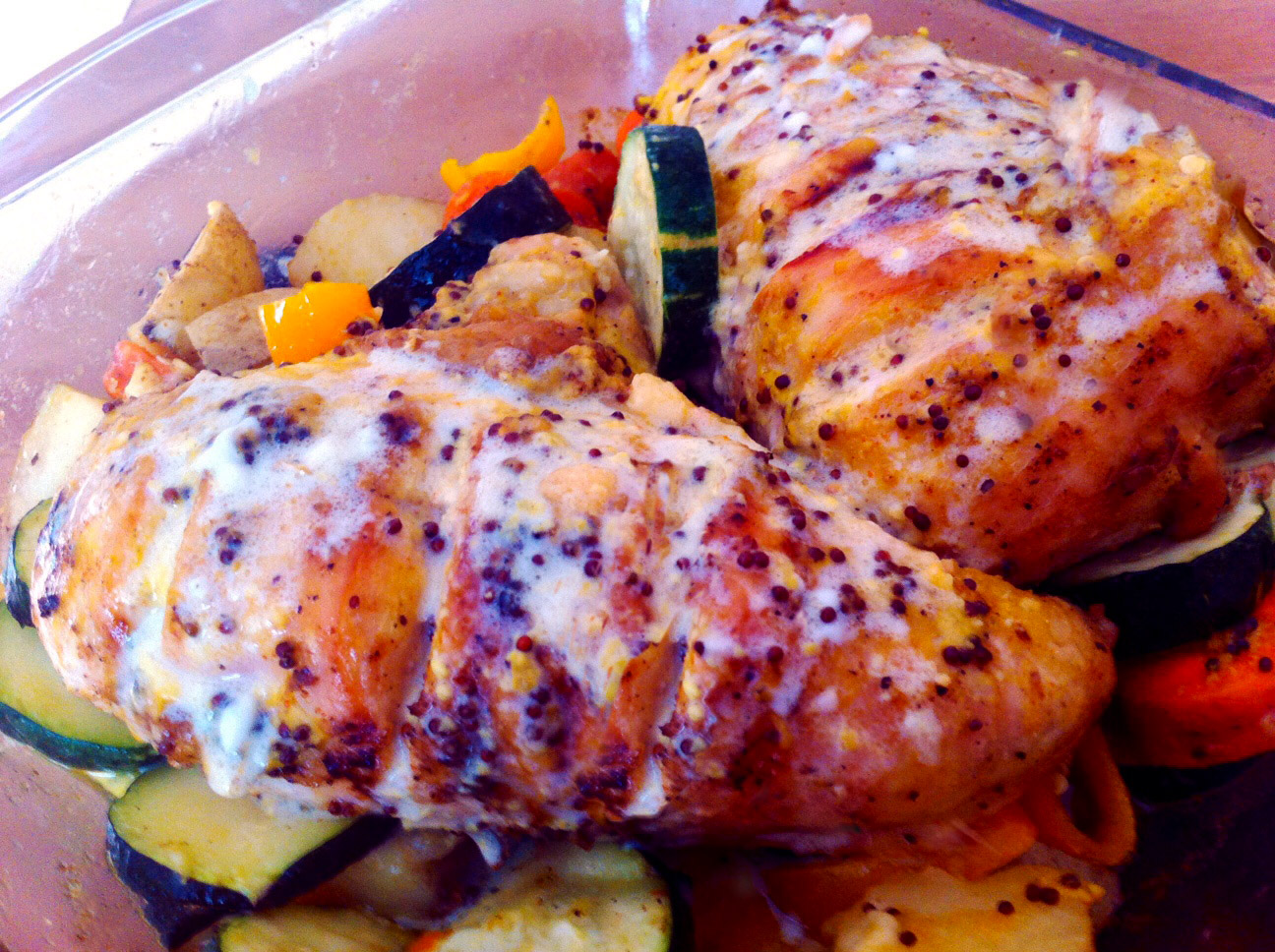 Pan seared chicken drizzled with mustard sauce and vegetables