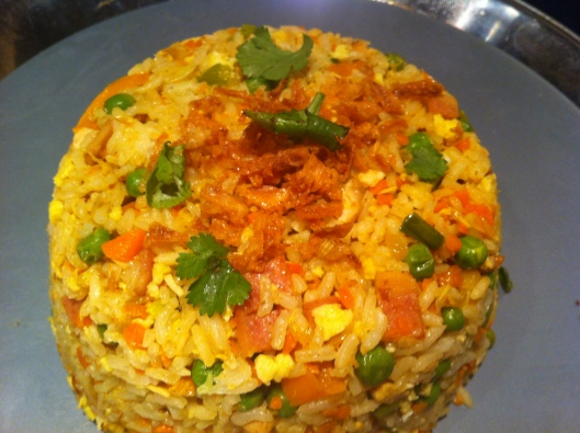 Bacon fried rice garnished with onions and cilantro