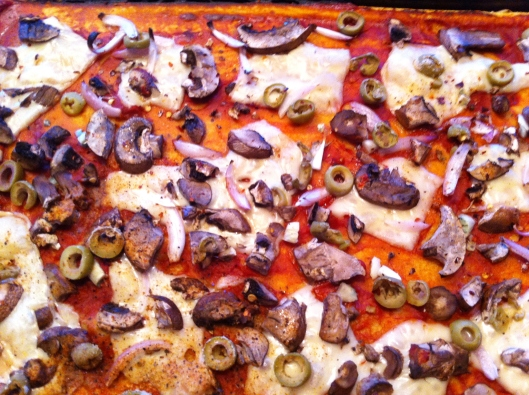 Chickpea flour pizza with mushrooms and olives