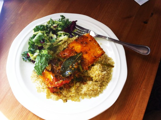 salmon curry served with quinoa and salad